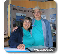 Photo of discovery center volunteers Jim and Becky Jewell greeting visitors
