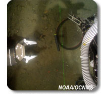 Picture of some of the remotely operated vehicle tools gathering rock samples from the ocean bottom