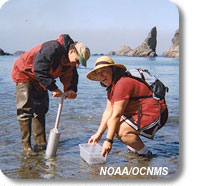 Photo of a teacher training a student on gathering samples from the water