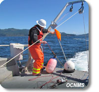 Oceanographer Rick Fletcher deploys a research mooring from R/V Tatoosh.